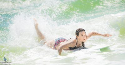 Model Stacy Chrisco body surfing as part of a music video shoot in Okaloosa Island, Florida. Photographed by Alexander Rea of Inspire to Aspire.