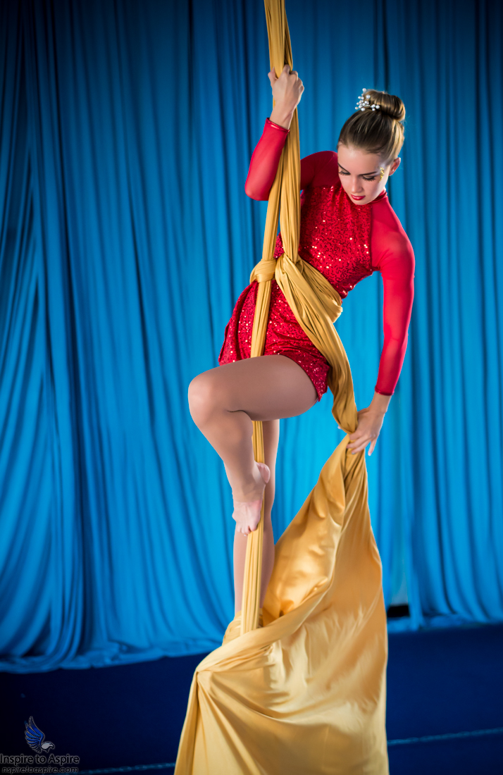 Mila Strelets, a marvelously talented model, nutritional coach and aerial dancer, conquering the thin air with only cloth to maneuver on. Photographed by Alexander Rea of Inspire to Aspire.